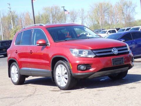 2014 Volkswagen Tiguan for sale at Szott Ford in Holly MI