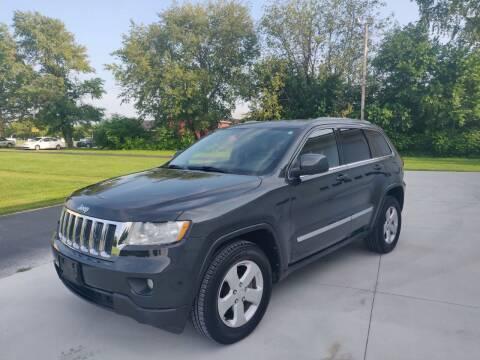 2011 Jeep Grand Cherokee for sale at Carmart Auto Sales Inc in Schoolcraft MI