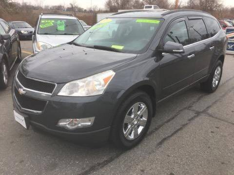 2011 Chevrolet Traverse for sale at Howe's Auto Sales in Lowell MA