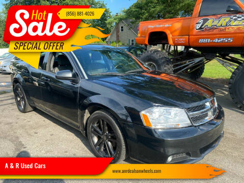 2012 Dodge Avenger for sale at A & R Used Cars in Clayton NJ
