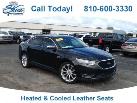 2013 Ford Taurus for sale at Erick's Used Car Factory in Flint MI