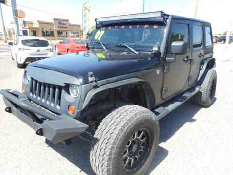 2007 Jeep Wrangler Unlimited for sale at AUGE'S SALES AND SERVICE in Belen NM