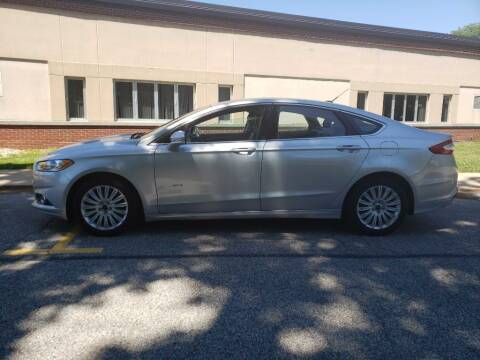 2014 Ford Fusion Hybrid for sale at The Car Mart in Milford IN
