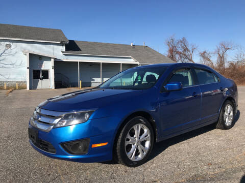 2012 Ford Fusion for sale at D'Ambroise Auto Sales in Lowell MA