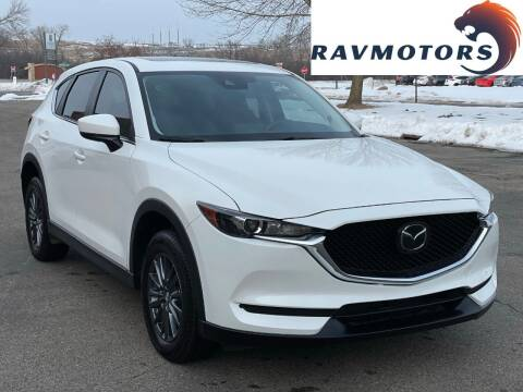 2019 Mazda CX-5 for sale at RAVMOTORS in Burnsville MN