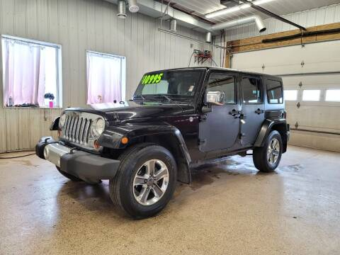2011 Jeep Wrangler Unlimited for sale at Sand's Auto Sales in Cambridge MN