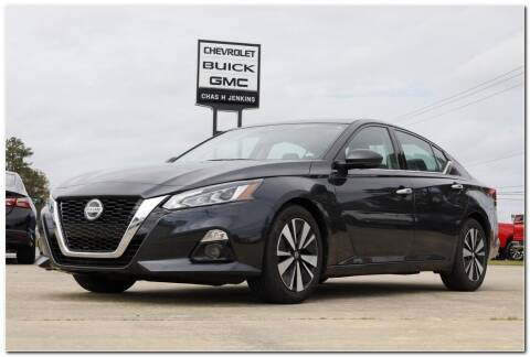 2019 Nissan Altima for sale at STRICKLAND AUTO GROUP INC in Ahoskie NC