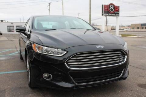 2014 Ford Fusion for sale at B & B Car Co Inc. in Clinton Twp MI