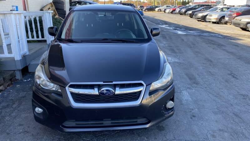 2013 Subaru Impreza for sale at SUN AUTOMOTIVE in Greensboro NC