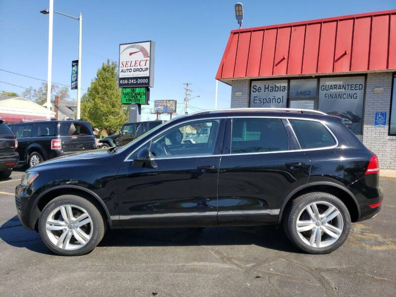 2014 Volkswagen Touareg for sale at Select Auto Group in Wyoming MI
