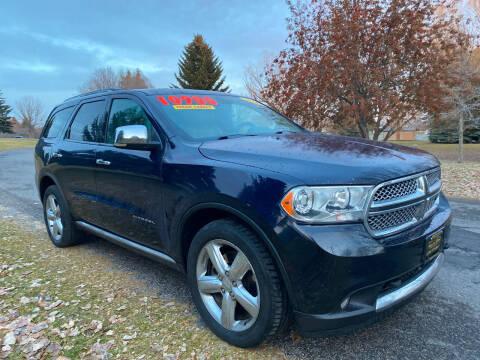 2012 Dodge Durango for sale at BELOW BOOK AUTO SALES in Idaho Falls ID