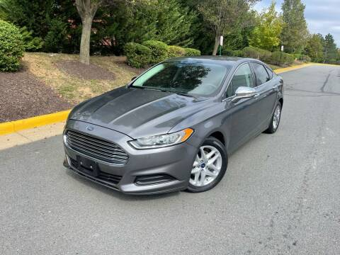 2014 Ford Fusion for sale at Aren Auto Group in Sterling VA