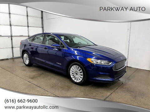 2013 Ford Fusion Hybrid for sale at PARKWAY AUTO in Hudsonville MI