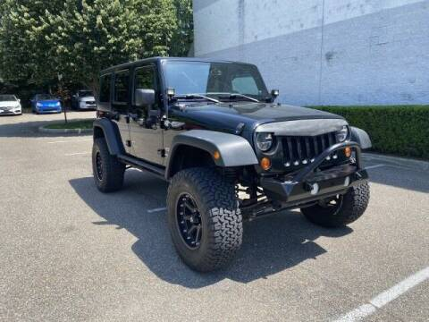 2013 Jeep Wrangler Unlimited for sale at Select Auto in Smithtown NY