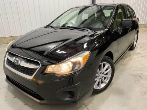 2012 Subaru Impreza for sale at EUROPEAN AUTOHAUS, LLC in Holland MI