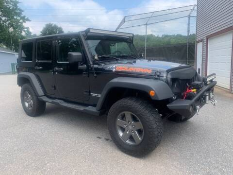 2010 Jeep Wrangler Unlimited for sale at Connecticut Auto Wholesalers in Torrington CT