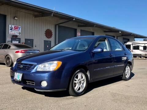 2004 Kia Spectra for sale at DASH AUTO SALES LLC in Salem OR