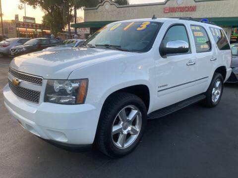 2013 Chevrolet Tahoe for sale at La Mesa Auto Sales in Huntington Park CA