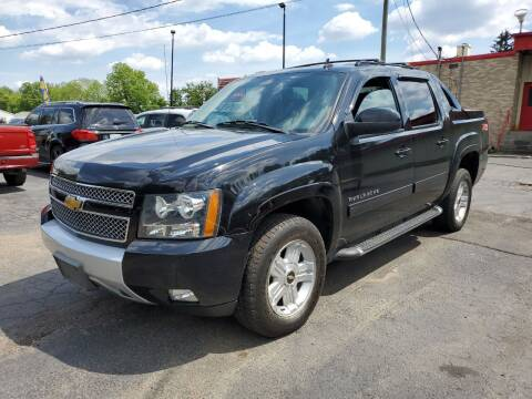 2013 Chevrolet Avalanche for sale at Drive Motor Sales in Ionia MI