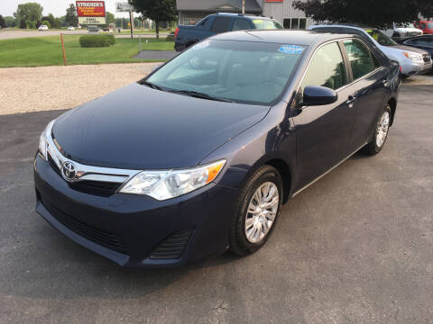 2014 Toyota Camry for sale at JACK'S AUTO SALES in Traverse City MI