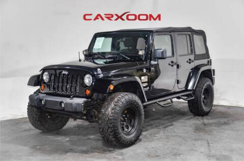 2011 Jeep Wrangler Unlimited for sale at CarXoom in Marietta GA