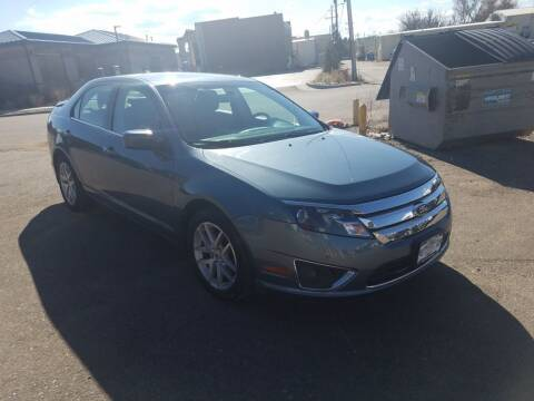 2012 Ford Fusion for sale at BERKENKOTTER MOTORS in Brighton CO