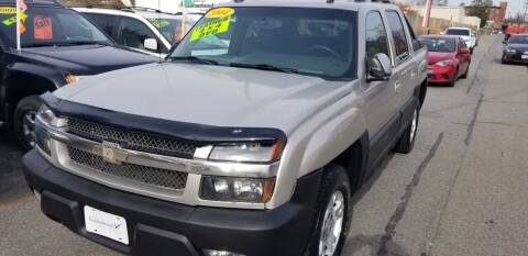 2004 Chevrolet Avalanche for sale at Howe's Auto Sales in Lowell MA