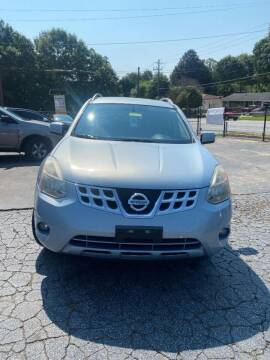 2013 Nissan Rogue for sale at LAKE CITY AUTO SALES in Forest Park GA