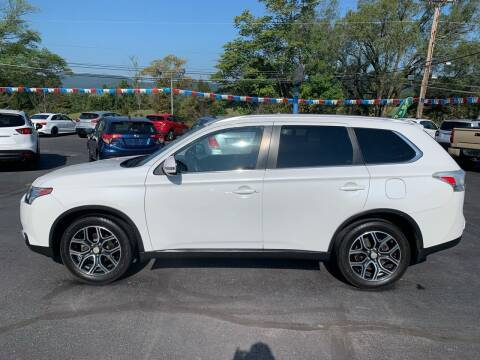 2015 Mitsubishi Outlander for sale at MAGNUM MOTORS in Reedsville PA