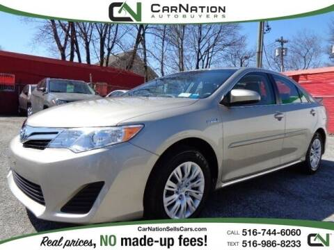 2014 Toyota Camry Hybrid for sale at CarNation AUTOBUYERS, Inc. in Rockville Centre NY