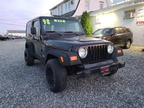 1998 Jeep Wrangler for sale at Reyes Automotive Group in Lakewood NJ