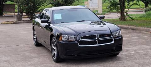 2014 Dodge Charger for sale at America's Auto Financial in Houston TX