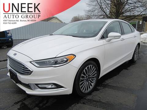 2017 Ford Fusion for sale at Uneek Auto Group LLC in Burton MI