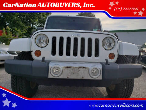 2012 Jeep Wrangler Unlimited for sale at CarNation AUTOBUYERS, Inc. in Rockville Centre NY