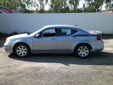 2014 Dodge Avenger for sale at Chaddock Auto Sales in Rochester MN