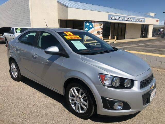 2014 Chevrolet Sonic for sale at Miracle Motor Cars Inc. in Victorville CA