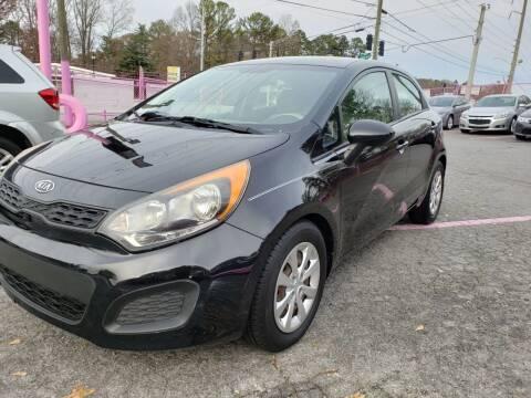 2012 Kia Rio5 for sale at Fast and Friendly Auto Sales LLC in Decatur GA