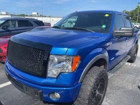 2012 Ford F-150 for sale at BILLY HOWELL FORD LINCOLN in Cumming GA