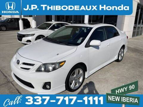 2013 Toyota Corolla for sale at J P Thibodeaux Used Cars in New Iberia LA