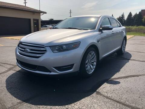 2014 Ford Taurus for sale at Mike's Budget Auto Sales in Cadillac MI