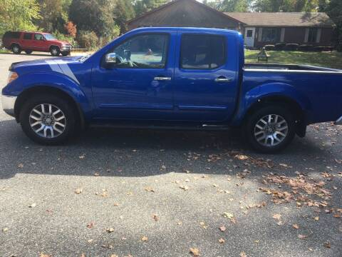 2013 Nissan Frontier for sale at Lou Rivers Used Cars in Palmer MA