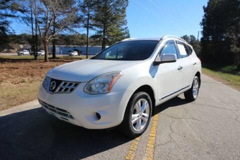 2013 Nissan Rogue for sale at Oak City Motors in Garner NC