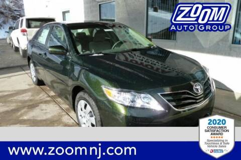 2011 Toyota Camry for sale at Zoom Auto Group in Parsippany NJ