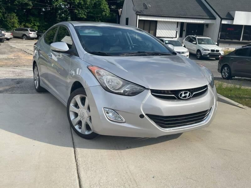 2012 Hyundai Elantra for sale at Alpha Car Land LLC in Snellville GA