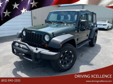 2011 Jeep Wrangler Unlimited for sale at Driving Xcellence in Jeffersonville IN