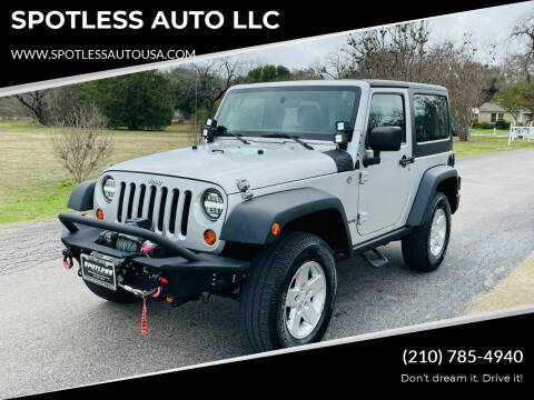 2011 Jeep Wrangler for sale at SPOTLESS AUTO LLC in San Antonio TX