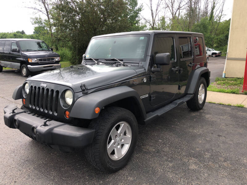 2010 Jeep Wrangler Unlimited for sale at Lance's Automotive in Ontario NY
