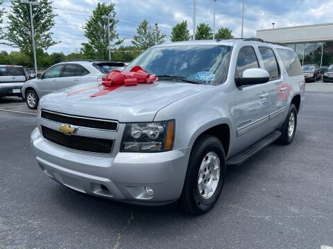 2013 Chevrolet Suburban for sale at Charlotte Auto Group, Inc in Monroe NC