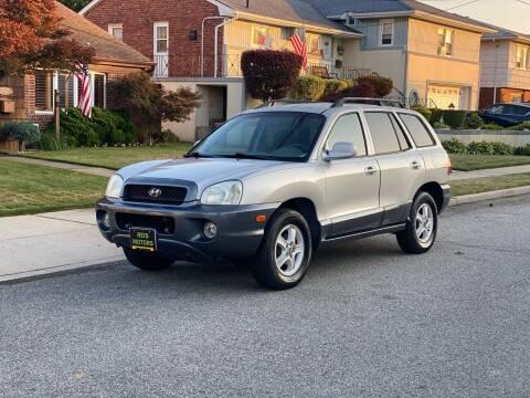 2004 Hyundai Santa Fe for sale at Reis Motors LLC in Lawrence NY