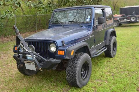 2002 Jeep Wrangler for sale at HOUSTON MOTORS in Stafford TX